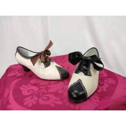 Zapatos de loneta y cuero....