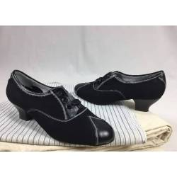 Zapatos de ante y cuero negro