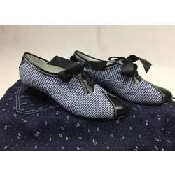 Zapatos forrados de tejido...