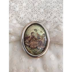 Antiguo broche romántico