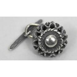 Botón en plata vieja